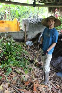 Our volunteer Anthony - happy while making new layer of compost.